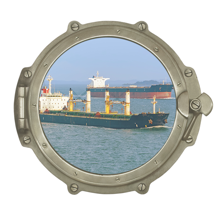 Bulk handler ships as viewed through porthole